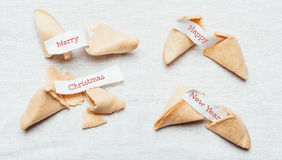 Fortune cookie. Four fortune cookies with season greetings on table cloth Stock Photography