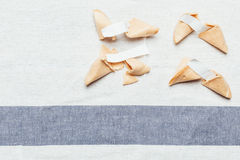 Fortune cookie. Four fortune cookies on table cloth Stock Photo