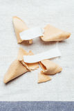 Fortune cookie. Four fortune cookies on table cloth Royalty Free Stock Photo