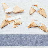 Fortune cookie. Four fortune cookies on table cloth Stock Photos