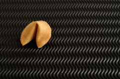 A fortune cookie. Isolated on a black background Stock Photography