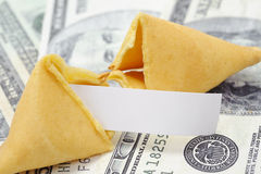 Fortune cookie with money. Fortune cookie with blank fortune on money Royalty Free Stock Image