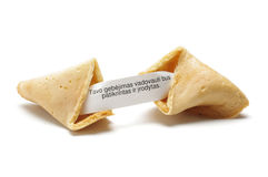 Fortune cookie with phrase in lithuanian language. Fortune cooky is bakery with the note inside stock photography