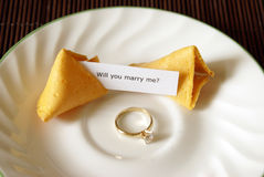 Fortune Cookie Proposal. A marriage proposal using a fortune cookie and gold ring Stock Photos