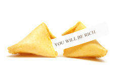 Fortune Cookie of Riches. A cracked fortune cookie with the message stating that you will be rich Stock Images