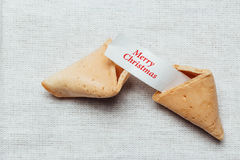 Fortune cookie. With season greetings on table cloth Royalty Free Stock Photography