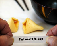 Fortune Cookie Surprise. An unsuspecting customer gets a disturbing fortune cookie Stock Image