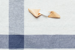 Fortune cookie. On table cloth Royalty Free Stock Photo