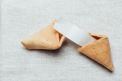 Fortune cookie. On table cloth Stock Photos