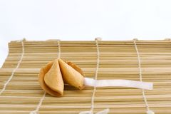 Fortune cookie with text area. Fortune cookie with blank strip of paper for your own predictions Royalty Free Stock Images