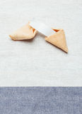 Fortune cookie. On white and blue table cloth Royalty Free Stock Photography