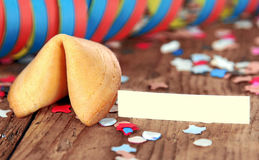 Fortune cookie. Wooden Background with fortune Cookie and streamer Royalty Free Stock Photography