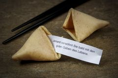 Fortune cookie on wooden table royalty free stock photo