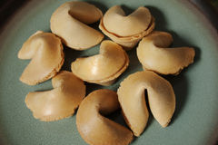 Fortune cookies. Several fortune cookies on a plate stock photo