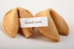 Fortune cookies. A couple of fortune cookies with a blanc white note Royalty Free Stock Photography