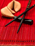 Fortune cookies and black chopsticks. Chinese new year concept Stock Photography