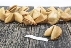 Fortune cookies with blank paper. On the wooden table royalty free stock photos