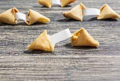 Fortune cookies with blank paper. On the wooden table stock photo
