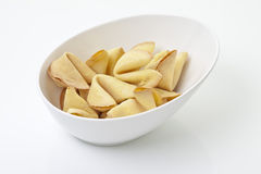 Fortune cookies in bowl on white background Royalty Free Stock Photography