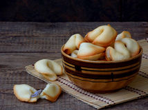 Fortune cookies in bowl. On a wooden background. Copy space Royalty Free Stock Image
