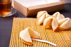 Fortune cookies and cup of tea on the wooden table royalty free stock images