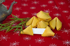 Fortune cookies and old teapot Stock Photography