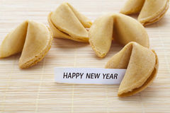 Fortune cookies. Open fortune cookie stating that happy new year stock image