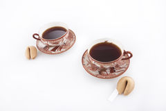 Fortune Cookies. Oriental cups of tea with fortune cookies Royalty Free Stock Image