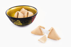 Fortune cookies. A small old wooden bowl filled with fortune cookies Stock Photography