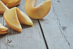 Fortune cookies on a table. Fortune cookies on a wooden table background royalty free stock photography
