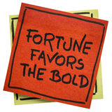 Fortune favors the bold inspirational slogan. Handwriting on an isolated sticky note stock image