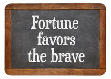 Fortune favors the brave - blackboard sign Stock Photography