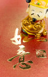 Fortune God. Carrying ancient gold coin wishing prosperity Stock Photos