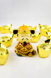 Fortune God. Carrying and surrounded by ancient gold ingot wishing prosperity with white background Royalty Free Stock Photography