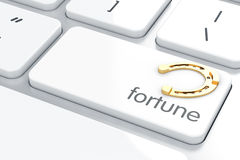 Fortune. Horseshoe button on keyboard with soft focus Stock Photo