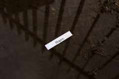 Fortune message. Fortune misfortune message hopes in a dirty puddle royalty free stock photos