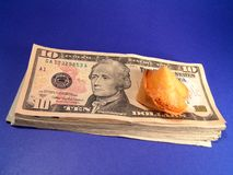 Fortune Money. A pile of cash and a fortune cookie stock images