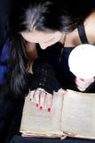 Fortune Teller. The girl leaned over the fortune-teller of ancient books Stock Photos