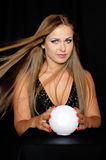 Fortune Teller. Beautiful girl with the ball for divination Royalty Free Stock Photos