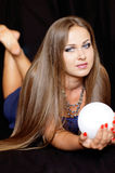 Fortune Teller. Beautiful girl with the crystal ball for divination Royalty Free Stock Photo