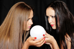 Fortune Teller. Beautiful girls with the ball for divination Royalty Free Stock Images