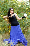 Fortune Teller. Beautiful girl with the crystal ball for divination Stock Photography