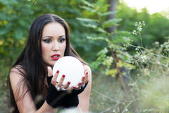 Fortune Teller. Beautiful girl with the crystal ball for divination Royalty Free Stock Photos