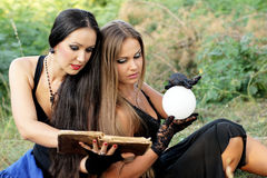 Fortune Teller. Beautiful girls with the ball for divination Royalty Free Stock Photo