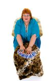 Fortune teller. Self confident obese middle aged female fortune teller. Studio, white background Royalty Free Stock Photos