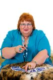 Fortune teller. Self confident obese middle aged female fortune teller. Studio, white background Stock Photography