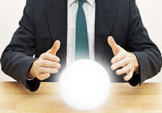 Fortune teller businessman predicting future with crystal ball Stock Images