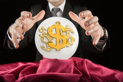 Fortune teller businessman, sees the dollar in a crystal ball Royalty Free Stock Photography