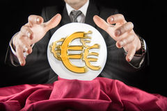 Fortune teller businessman, sees Euro sign in a crystal ball Stock Photography