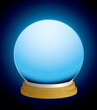 Fortune teller crystal ball. Glass fortune teller crystal ball with glowing background and wood base Royalty Free Stock Photos